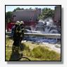 Klapband veroorzaakt brand in oplegger vrachtwagen op A58 [+foto]
